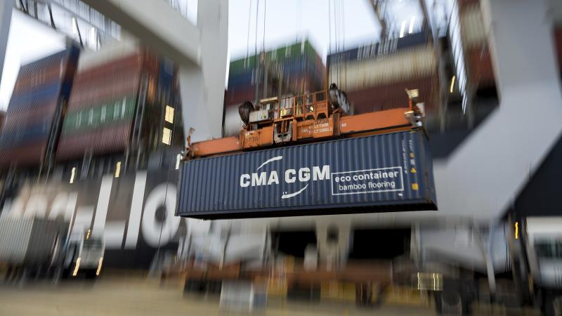 FILE - In this June, 19, 2018, file photo, a ship to shore crane lifts a CMA CGM Group shipping container onto the Hapag-Lloyd Teno at the Port of Savannah in Savannah, Ga. Manufacturers are facing stunted growth amid the damaging trade war between the U.S. and China, and that has some on Wall Street worried that it will crimp the consumer-fueled economy.  (AP Photo/Stephen B. Morton, File)