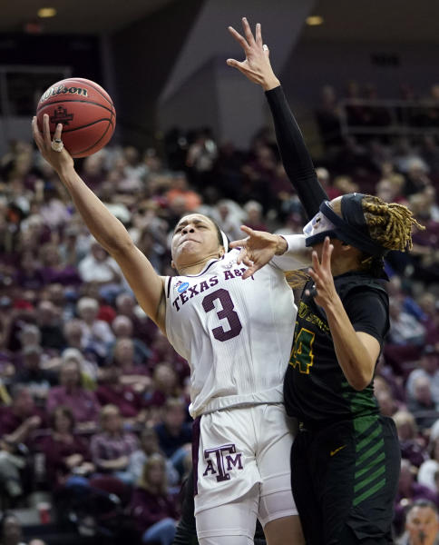 Texas A&M's Chennedy Carter (3) is fouled by Wright State's Michal Miller (24) during the first half of a first round women's college basketball game in the NCAA Tournament Friday, March 22, 2019, in College Station, Texas. (AP Photo/David J. Phillip)