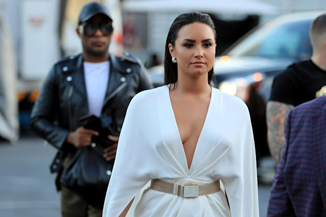 <p>Singer Demi Lovato arrives for the super welterweight boxing match between Floyd Mayweather Jr. and Conor McGregor on August 26, 2017 at T-Mobile Arena in Las Vegas, Nevada. (Photo by Sean M. Haffey/Getty Images) </p>