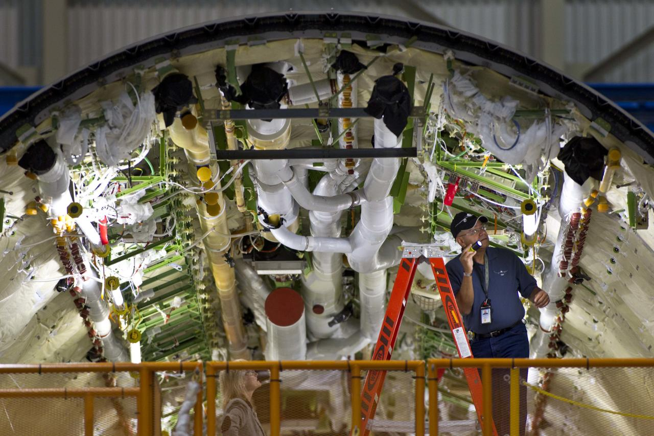 A worker looks over the inside of a fuselage of a Boeing Co. 787 at the assembly plant in Everett, Wash. on Sunday, Sept. 25, 2011. All Nippon Airways (ANA) is the first customer to take delivery of the 787. (AP Photo/John Froschauer)