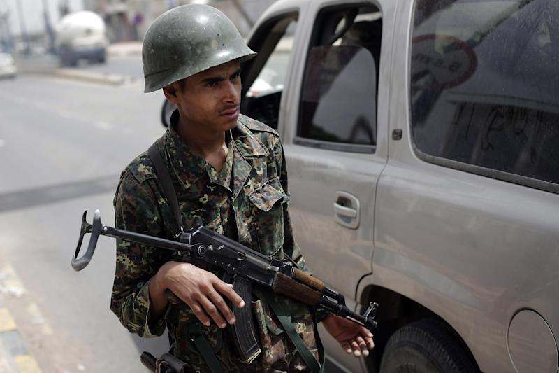 A Yemeni police trooper mans a checkpoint amid an increase in security following an announcement last week by Yemeni authorities that they had discovered an al-Qaida plot to target foreign embassies and international shipping in the Red Sea, in Sanaa, Yemen, Monday, Aug. 12, 2013. The leader of the Yemen-based al-Qaida offshoot vowed in a message posted Monday to free fellow militants from prisons and urged jailed fighters to remain faithful to the terror group's ideology. (AP Photo/Hani Mohammed)