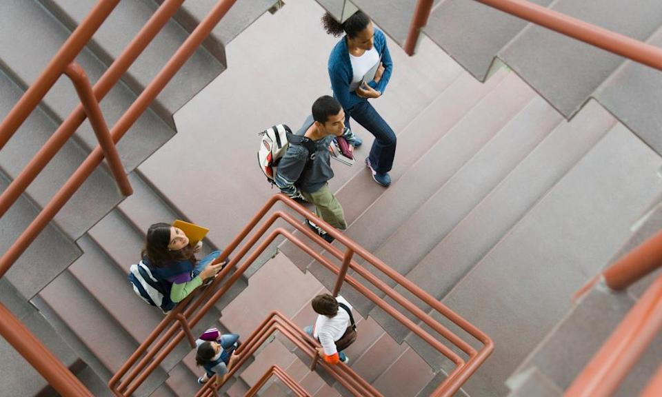 Students walking up staircase, elevated view