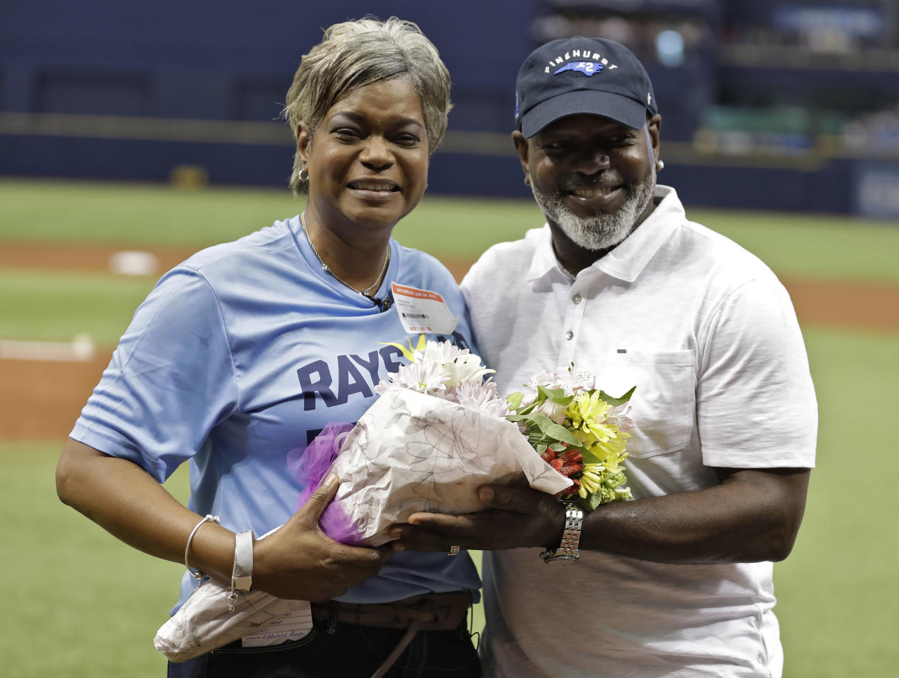 Marsha Smith-Hill, left, poses with her brother, NFL Hall of Fame player Emmitt Smith, after throwing out a ceremonial first pitch before a baseball game between the Tampa Bay Rays and the Baltimore Orioles, Saturday, June 24, 2017, in St. Petersburg, Fla. Smith-Hill is a cancer survivor. (AP Photo/Chris O'Meara)