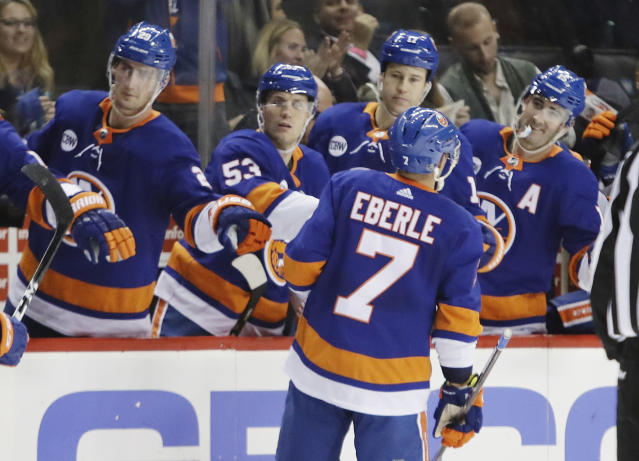 Florida Panthers' Colton Sceviour (7) celebrates with teammates after scoring a goal during the second period of an NHL hockey game against the New York Islanders Wednesday, Oct. 24, 2018, in New York. (AP Photo/Frank Franklin II)