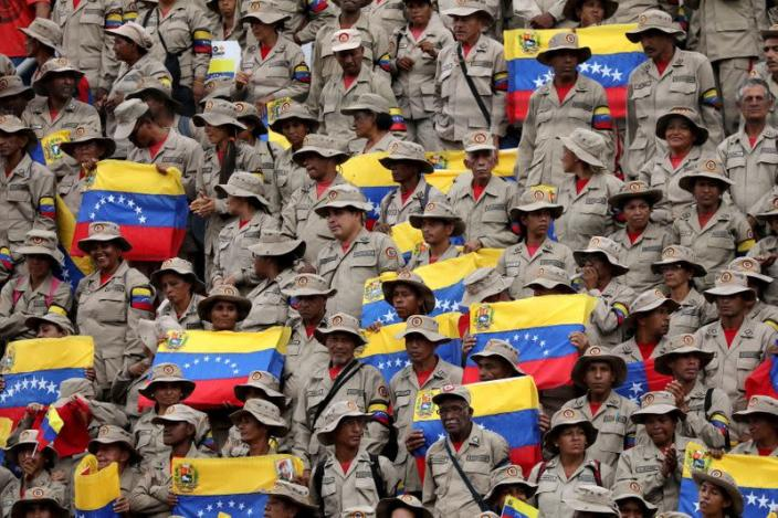 FILE PHOTO: Militia members take part in a rally against the U.S. sanctions on Venezuela, in Caracas