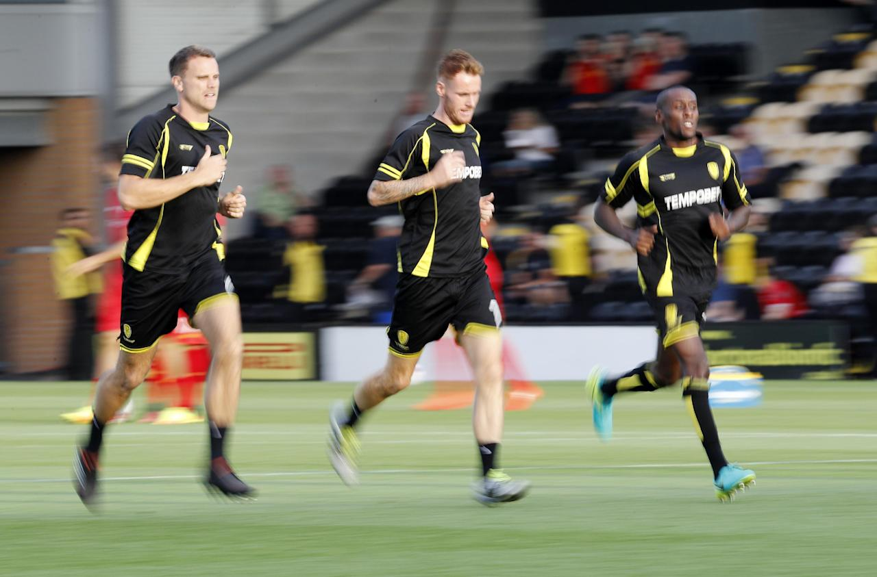 """Football Soccer Britain - Burton Albion v Liverpool - EFL Cup Second Round - Pirelli Stadium - 23/8/16 Burton Albion's Tom Naylor warms up before the match  Reuters / Darren Staples Livepic EDITORIAL USE ONLY. No use with unauthorized audio, video, data, fixture lists, club/league logos or """"live"""" services. Online in-match use limited to 45 images, no video emulation. No use in betting, games or single club/league/player publications.  Please contact your account representative for further details."""