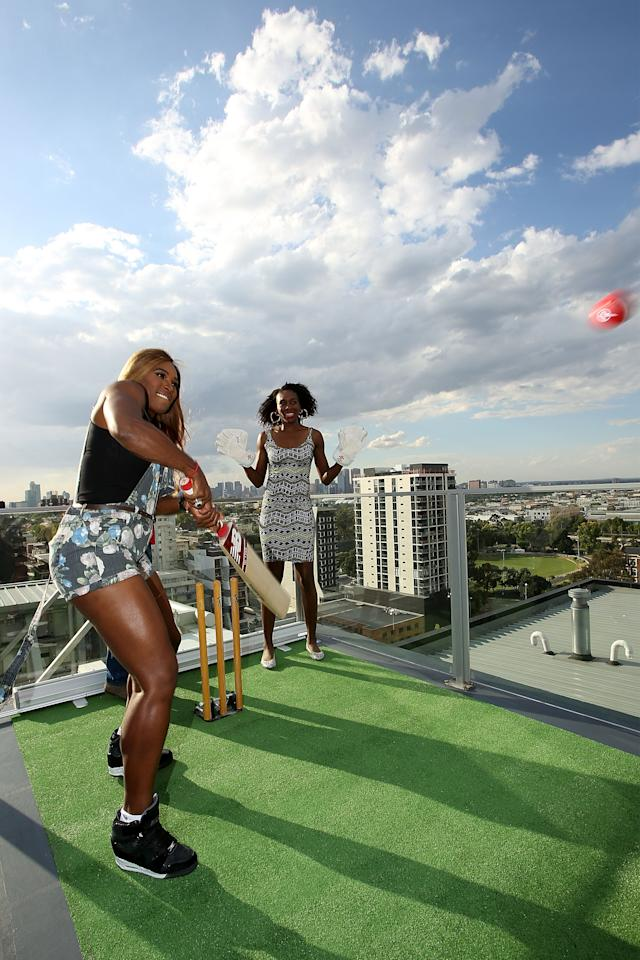 MELBOURNE, AUSTRALIA - JANUARY 09: Venus Williams (L) and sister Serena Williams of the USA try cricket batting after being coached by Melbourne Renegades players Muthiah Muralidaran and Aaron Finch during a meet & greet with the Melbourne Renegades at The Olsen on January 9, 2014 in Melbourne, Australia. (Photo by Graham Denholm/Getty Images)