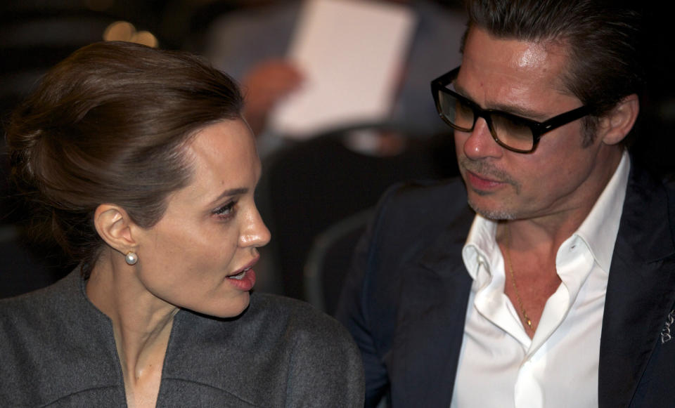 LONDON, UNITED KINGDOM - JUNE 13: UN Special Envoy and actress Angelina Jolie (L), actor Brad Pitt (R), British Foreign Secretary William Hague (not seen) and his wife Ffion Hague (not seen) attend the Global Summit To End Sexual Violence In Conflict in London, United Kingdom on June 13, 2014. The four-day conference on sexual violence in war is hosted by Foreign Secretary William Hague and UN Special Envoy and actress Angelina Jolie. (Photo by Yunus Kaymaz/Anadolu Agency/Getty Images)