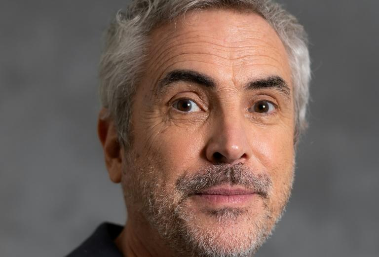 """""""Roma"""" director Alfonso Cuaron-- posing here for AFP at a photo session before the 91st Oscars Nominees Luncheon on February 4, 2019 -- says he intentionally changed the rules of filmmaking on the personal project"""