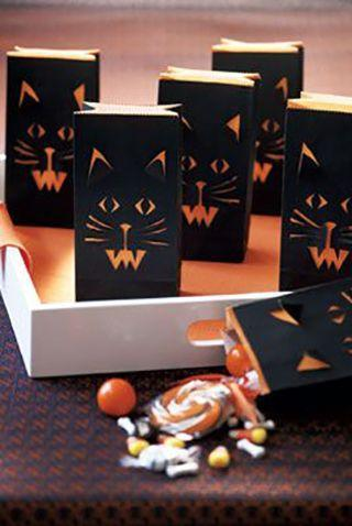 """<p>Send your kids to school with these cat face treat bags for a tasty lunch treat.</p><p><em><strong><a href=""""https://www.womansday.com/home/crafts-projects/how-to/a5875/halloween-craft-how-to-cat-face-treat-bags-123825/"""" rel=""""nofollow noopener"""" target=""""_blank"""" data-ylk=""""slk:Get the Cat Face Treat Bags tutorial."""" class=""""link rapid-noclick-resp"""">Get the Cat Face Treat Bags tutorial.</a></strong></em></p>"""