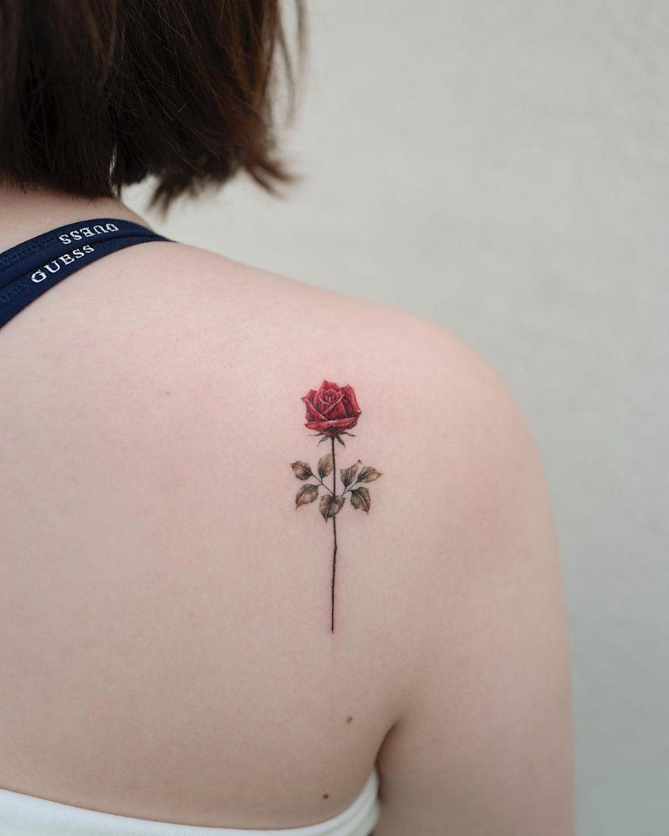 Roses are red, violets are blue, sugar is sweet—and we love this watercolor tattoo.