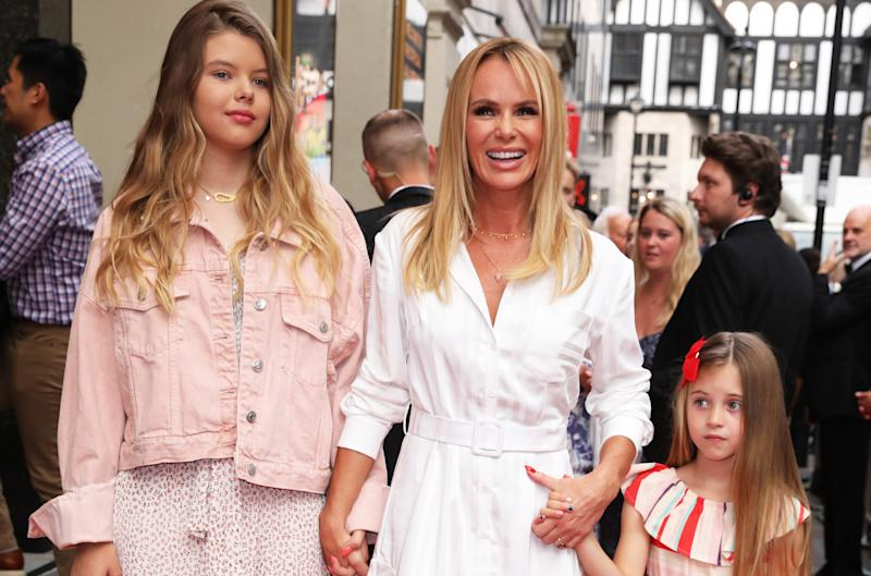 Amanda Holden with daughters Alexa and Hollie (Credit: PA)