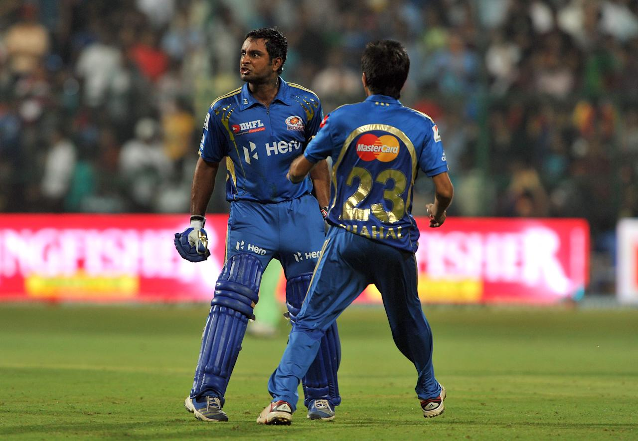 Mumbai Indians player Yuzvendra Chahal (R) tries to stop batsman Ambatti Rayadu from a confrontation with Royal Challengers Bangalore players after winning the IPL Twenty20 cricket match between Royal Challengers Bangalore and Mumbai Indians at the M. Chinnaswamy Stadium in Bangalore on May 14, 2012.    RESTRICTED TO EDITORIAL USE. MOBILE USE WITHIN NEWS PACKAGE.   AFP PHOTO/Manjunath KIRAN        (Photo credit should read Manjunath Kiran/AFP/GettyImages)