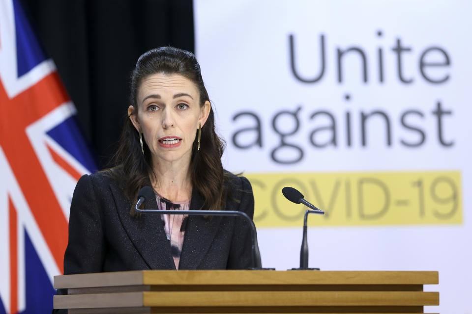 WELLINGTON, NEW ZEALAND - APRIL 09: Prime Minister Jacinda Ardern speaks to media during a press conference at Parliament on April 09, 2020 in Wellington, New Zealand. New Zealand has been in lockdown since Thursday 26 March following tough restrictions imposed by the government to stop the spread of COVID-19 across the country.  A State of National Emergency is in place along with an Epidemic Notice to help ensure the continuity of essential Government business. Under the COVID-19 Alert Level Four measures, all non-essential businesses are closed, including bars, restaurants, cinemas and playgrounds. Schools are closed and all indoor and outdoor events are banned. Essential services will remain open, including supermarkets and pharmacies. Lockdown measures are expected to remain in place for around four weeks, with Prime Minister Jacinda Ardern warning there will be zero tolerance for people ignoring the restrictions, with police able to enforce them if required.  (Photo by Hagen Hopkins/Getty Images)