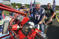 New England Patriots fan Billy Burrows, of Billerica, Mass., grills while tailgating prior to an NFL football game, Sunday, Sept. 12, 2021, in Foxborough, Mass. (AP Photo/Steven Senne)