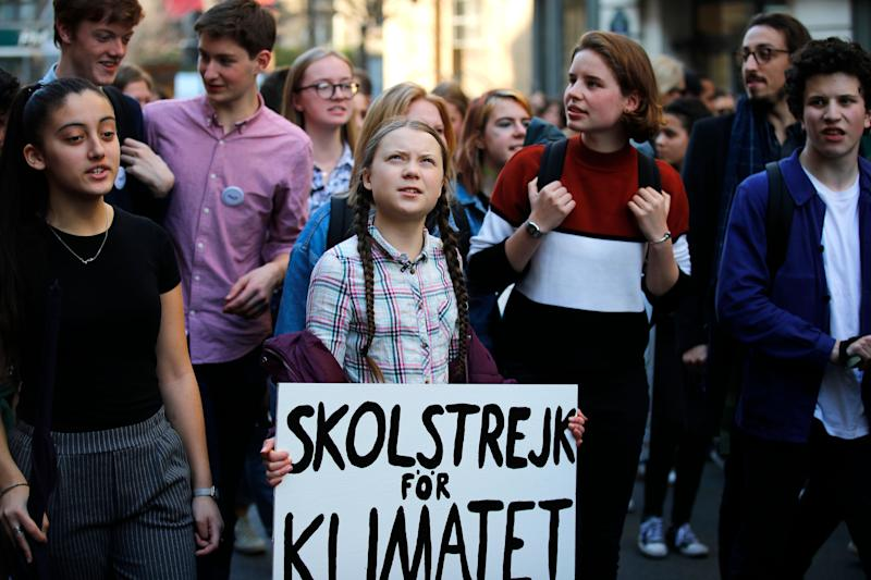 Swedish teenager Greta Thunberg, center, leads a march of thousands of French students through Paris, on Feb. 22, 2019.