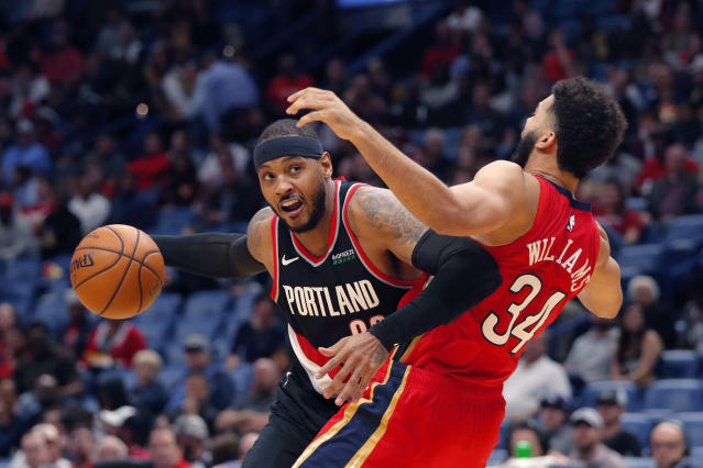 Blazers forward Carmelo Anthony works against the Pelicans' Kenrich Williams on Tuesday night. (AP Photo/Gerald Herbert)
