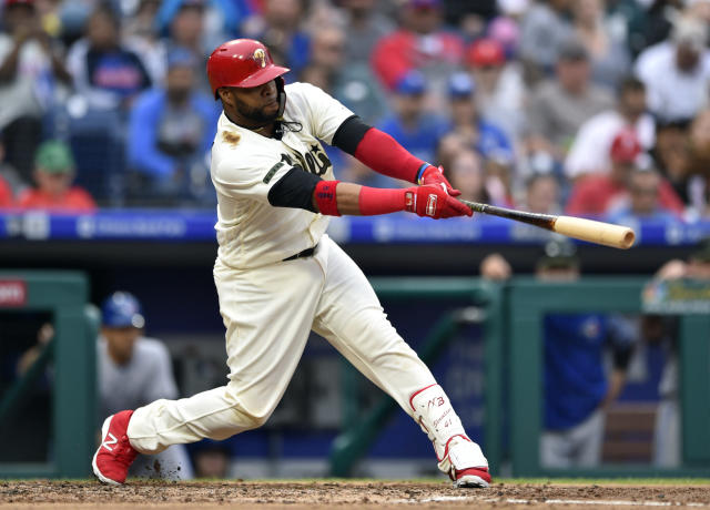 Philadelphia Phillies' Carlos Santana hits a single off Toronto Blue Jays' J.A. Happ during the fourth inning of a baseball game, Sunday, May 27, 2018, in Philadelphia. (AP Photo/Derik Hamilton)