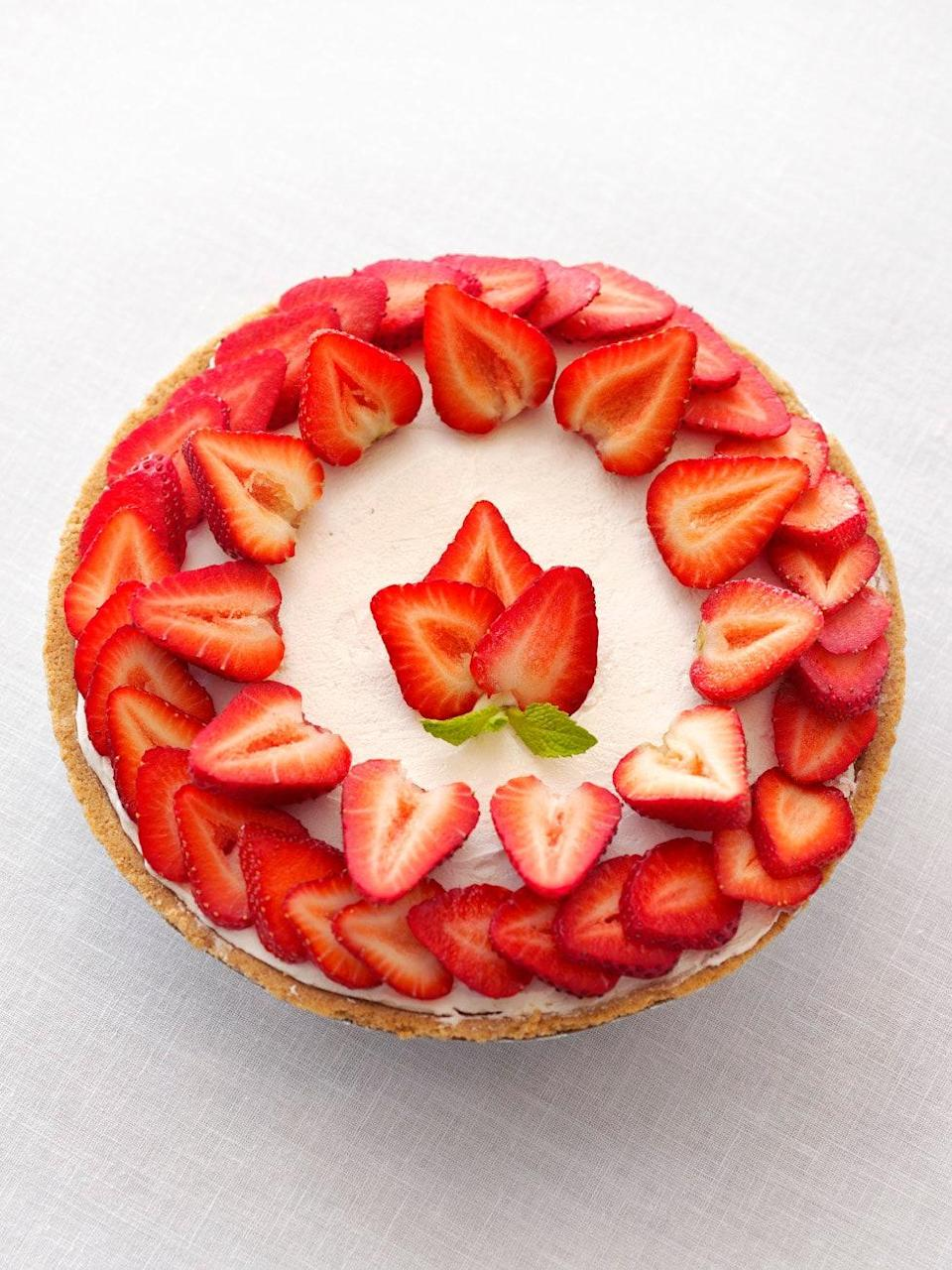 """This no-bake cheesecake is too pretty to eat (almost). Beat cream cheese with sugar, sour cream, and vanilla before folding in whipped cream. Scoop your mixture into a pie crust and let it chill in the fridge for four hours. Add the strawberries and the dessert is ready. <a href=""""https://www.epicurious.com/recipes/food/views/no-bake-strawberry-cheesecake-354029?mbid=synd_yahoo_rss"""" rel=""""nofollow noopener"""" target=""""_blank"""" data-ylk=""""slk:See recipe."""" class=""""link rapid-noclick-resp"""">See recipe.</a>"""
