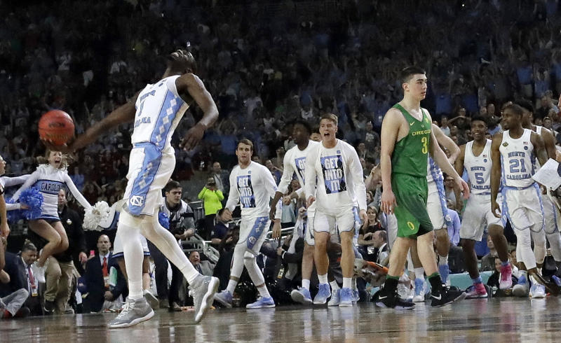 North Carolina's Theo Pinson (1) celebrates as Oregon's Payton Pritchard (3) walks off the court after the semifinals of the Final Four NCAA college basketball tournament, Saturday, April 1, 2017, in Glendale, Ariz. North Carolina won 77-76. (AP Photo/David J. Phillip)