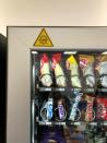 A vending machine installed with UV lights for sanitization is seen at Ericsson's office in Bucharest