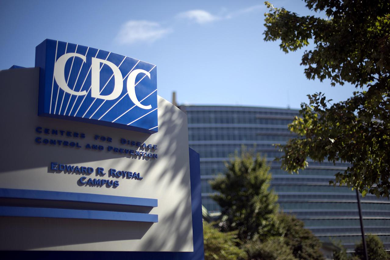 FILE - In this Oct. 8, 2013, file photo, a sign marks the entrance to the federal Centers for Disease Control and Prevention (CDC) in Atlanta. The CDC has canceled a Feb. 2017 conference on climate change and health but is not saying why publicly. (AP Photo/David Goldman, File)