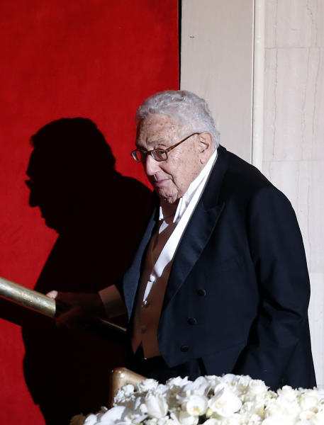 Former U.S. Secretary of State Henry Kissinger is introduced as he takes the dais during the Alfred E. Smith Memorial Foundation Dinner, a charity gala organized by the Archdiocese of New York, at the Waldorf-Astoria hotel, Thursday, Oct. 17, 2013, in New York. (AP Photo/Jason DeCrow)