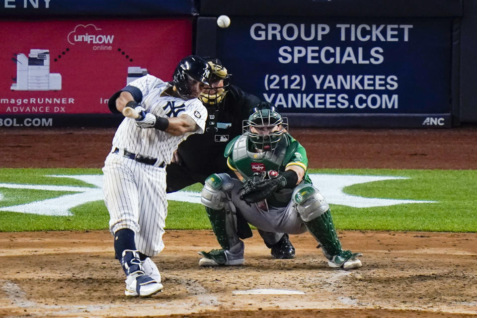 New York Yankees' Rougned Odor hits a home run during the fifth inning of the team's baseball game against the Oakland Athletics on Friday, June 18, 2021, in New York. (AP Photo/Frank Franklin II)