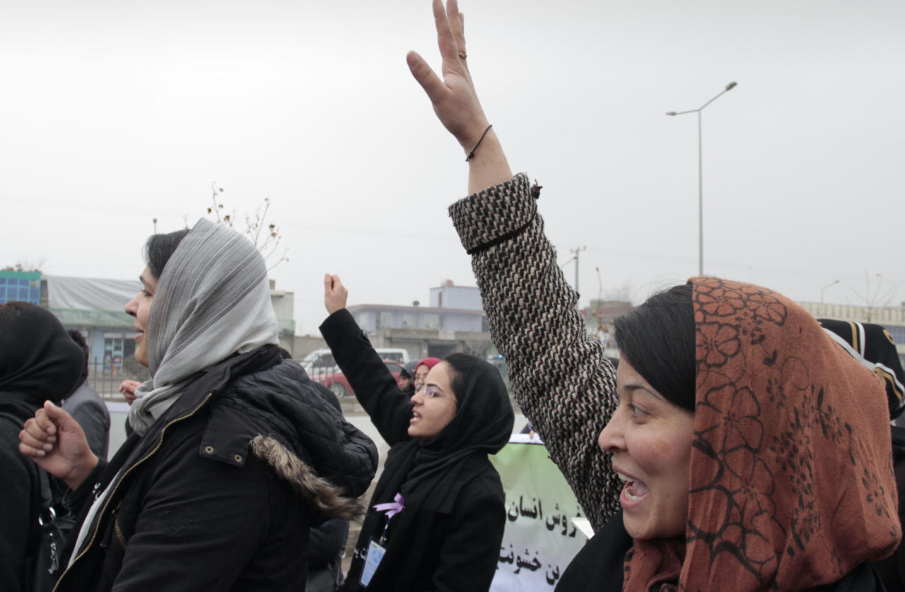 Afghan women chant slogans during a march calling for end of violence against women in Kabul, Afghanistan, Thursday, Feb. 14, 2013. Dozens of Afghan activists have marked Valentine's Day by marching in Kabul to denounce violence against women. Concern has risen after rights organizations last year found that Afghan women are frequently victims of violence — despite a law against it and increased prosecution of abusers. (AP Photo/Musadeq Sadeq)