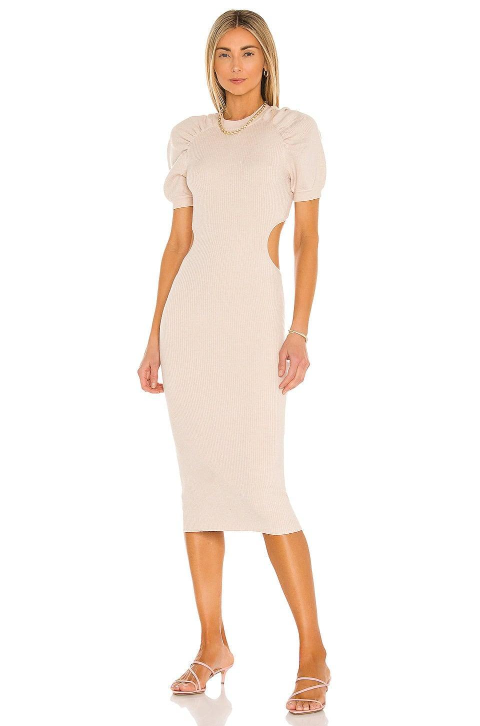 <p>We're loving the puff sleeves and side cut-outs of this <span>LPA Clementine Dress in Neutral</span> ($96, originally $198). Pair it with your favorite heels and take the city by storm. </p>