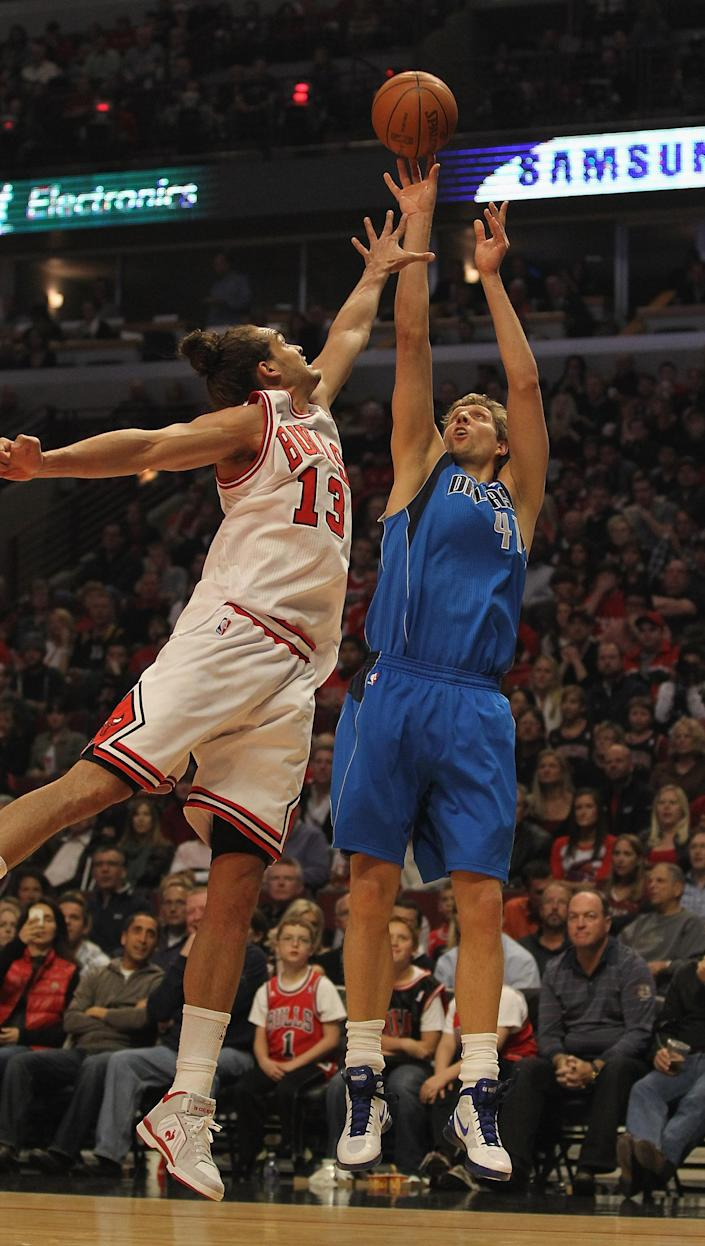 CHICAGO, IL - APRIL 21: Dirk Nowitzki #41 of the Dallas Mavericks shoots over Joakim Noah #13 of the Chicago Bulls at the United Center on April 21, 2012 in Chicago, Illinois. NOTE TO USER: User expressly acknowledges and agress that, by downloading and/or using this photograph, User is consenting to the terms and conditions of the Getty Images License Agreement. (Photo by Jonathan Daniel/Getty Images)