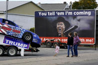 Supporters of President Donald Trump walk to a campaign rally at the Williamsport Regional Airport in Montoursville, Pa, Saturday, Oct. 31, 2020. (AP Photo/Gene J. Puskar)