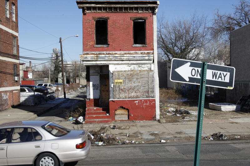 This Thursday, Feb. 10, 2011 photograph shows boarded-up buildings in Camden, N.J. The city has among the nation's highest unemployment, school dropout and homeless rates. The latest census data finds 53.6 percent of the city's residents in poverty, the highest in the nation. Camden was the nation's second-most dangerous city based on 2009 data, and it held the top spot the two previous years, according to CQ Press. The FBI reported 2,380 violent crimes per 100,000 residents in 2009 _ more than five times the national average. (AP Photo/Mel Evans)