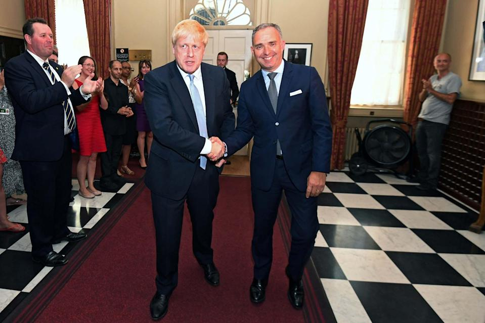 Boris Johnson shakes hands with Mark Sedwill following his appointment as Prime Minister: REUTERS