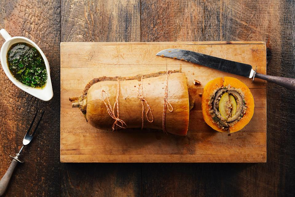 """This stunner of an entrée is an entirely meatless take on turducken, with <a href=""""https://www.epicurious.com/ingredients/best-butternut-squash-recipes?mbid=synd_yahoo_rss"""" rel=""""nofollow noopener"""" target=""""_blank"""" data-ylk=""""slk:butternut squash"""" class=""""link rapid-noclick-resp"""">butternut squash</a>, eggplant, and zucchini filling in for the usual suspects. <a href=""""https://www.epicurious.com/recipes/food/views/vegducken?mbid=synd_yahoo_rss"""" rel=""""nofollow noopener"""" target=""""_blank"""" data-ylk=""""slk:See recipe."""" class=""""link rapid-noclick-resp"""">See recipe.</a>"""