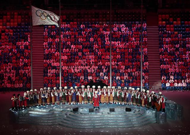 Performers sing on stage before the start of the closing ceremony of the 2014 Winter Olympics, Sunday, Feb. 23, 2014, in Sochi, Russia. (AP Photo/Ivan Sekretarev)