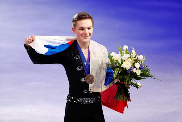 Figure Skating - World Figure Skating Championships - The Mediolanum Forum, Milan, Italy - March 24, 2018 Russia's Mikhail Kolyada poses with the bronze medal after the Men's Free Skating REUTERS/Alessandro Garofalo