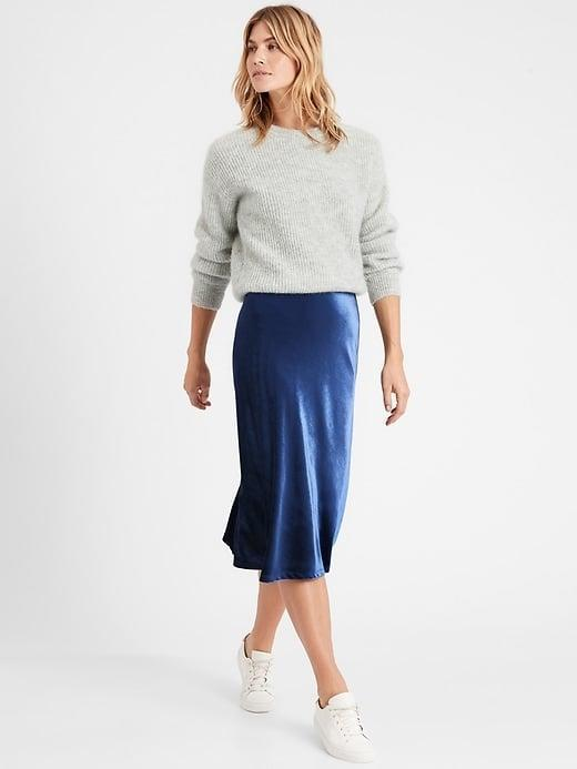 <p>There's just something about velvet that gets our pick this season and the <span>Banana Republic Velvet Bias-Cut Midi Skirt</span> ($64-$72, originally $99) is no exception, especially when layered with these <span>Banana Republic Control Top Opaque Tights</span> ($13, originally $23).</p>