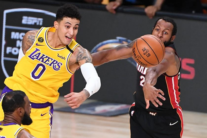 ORLANDO, FLORIDA OCTOBER 6, 2020-Lakers Kyle Kuzma and Heat's Andre Iguodala battle for a loose ball.