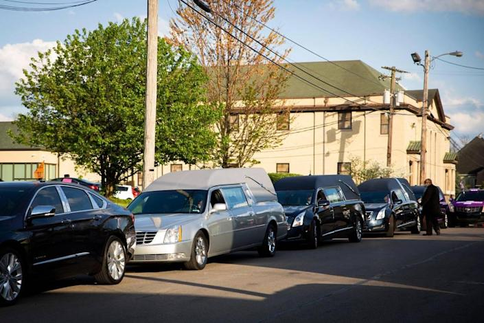"""Hearses line the street preparing for the during the symbolic funeral procession during the drive-in """"Stop the Violence"""" rally at Shiloh Baptist Church in Lexington, Ky., on Tuesday, April 20, 2021."""