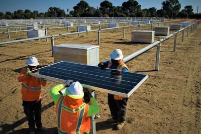 Workers installing the first of many Oregon-assembled SunPower Performance Series Solar Panels at a Gap Inc. distribution center in Fresno, Calif.