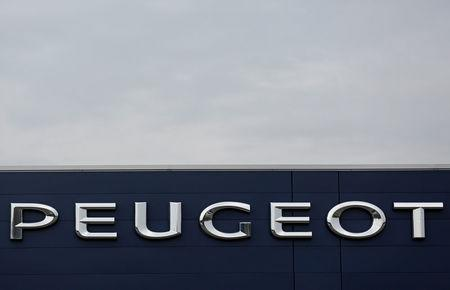 FILE PHOTO: The brand name of Peugeot, part of French carmaker PSA Group, is seen at a dealership of the brand in Saverne