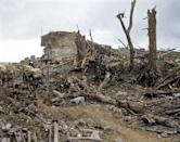 <p>Australian soldiers walking through a destroyed German outpost on 28th August, 1916 (Royston Leonard / Media Drum World / Caters News) </p>