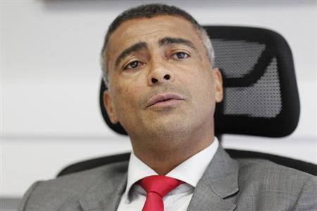 Brazil congressman and former soccer star Romario reacts during a news conference in Brasilia
