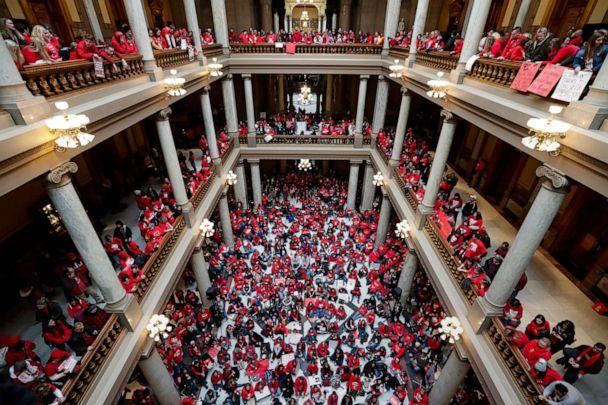 PHOTO: Thousands of Indiana teachers wearing red, hold rally at the Statehouse in Indianapolis, Nov. 19, 2019, calling for further increasing teacher pay in the biggest such protest in the state amid a wave of educator activism across the country. (Michael Conroy/AP)