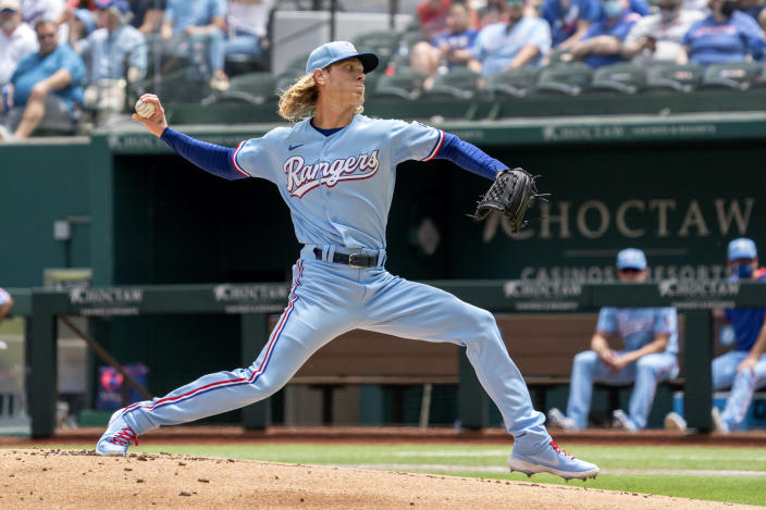 Texas Rangers starting pitcher Mike Foltynewicz works against the Boston Red Sox during the first inning of a baseball game Sunday, May 2, 2021, in Arlington, Texas. (AP Photo/Jeffrey McWhorter)