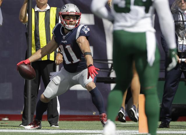 New England Patriots wide receiver Julian Edelman winds up to spike the ball after catching a touchdown pass against the New York Jets in the first half of an NFL football game, Sunday, Sept. 22, 2019, in Foxborough, Mass. (AP Photo/Steven Senne)