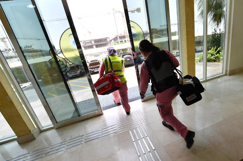 Maria Lagbes, a Philippines doctor with the Women Responders team, leaves the ambulance service headquarters after receiving an emergency call, on July 13, 2017, in Dubai (AFP Photo/GIUSEPPE CACACE)