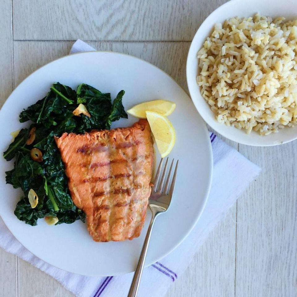 "<p>To our minds there is no better side to salmon than some garlicky, punchy kale. Squeeze lemon over everything and you've got a killer meal.</p><p>Get the recipe from <a href=""https://www.delish.com/cooking/recipe-ideas/recipes/a44646/soy-glazed-salmon-garlicky-kale-rice-recipe/"" rel=""nofollow noopener"" target=""_blank"" data-ylk=""slk:Delish"" class=""link rapid-noclick-resp"">Delish</a>.</p>"