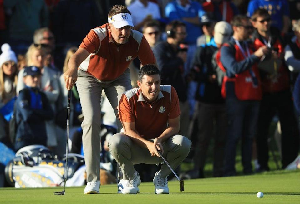 Rory McIlroy and Ian Poulter line up a putt during the foursomes in 2018  (Getty Images)